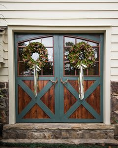 The main Barn door Entry welcomes you into a stone floored foyer & dining room