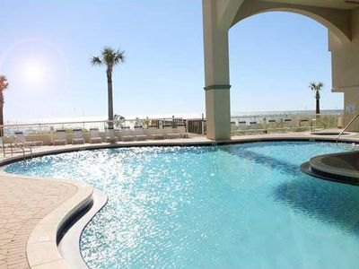 Enjoy the swimming pool next to the Condo, while viewing the Ocean privately.