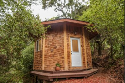 """This custom made 8 sided """"treehouse"""" is on a platform high up above the ground."""