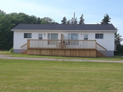 Here are the updated Deluxe Duplex Cottages, with new doors, deck with privacy wall, roof, siding, and rear windows.