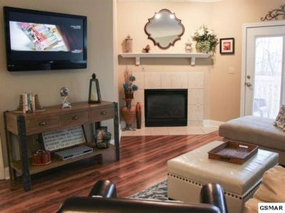 Living area with large flatscreen TV and cozy fireplace
