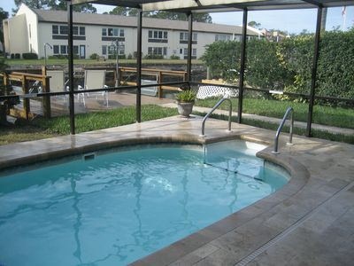 Private screened-in & heated pool with new pool deck & dock and pontoon boat.