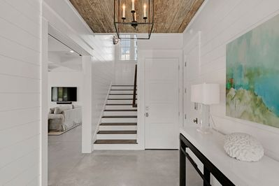 Foyer with beautiful pecky cypress ceiling.