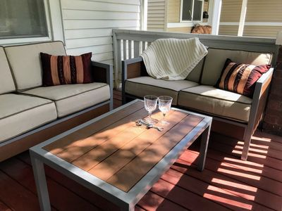 Plenty of seating on the front porch to enjoy.