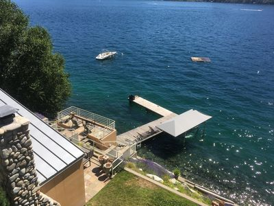 View from third level master suite of patio and L-shaped dock.