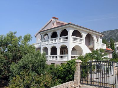 Photo for Apartment with pool in direct beach location and stunning sea views