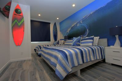 1st Floor Bedroom King & Twin XL Beds. Surfing Mural. 55-in TV.  Attached Bath