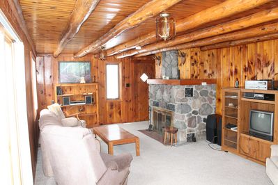 Stunning Knotty Pine Interior with Hand Cut Stone Fireplace