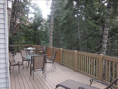 Enjoy your summer stay on the large private deck surrounded by mature pine trees