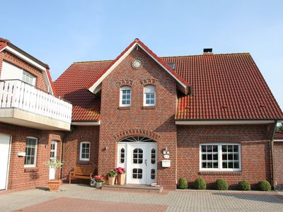 Photo for Haus am Park Comfortable apartment in the health resort Werdum at Neuharlingersiel