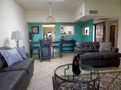 Living room and dining area. Counter top table with 4 chairs