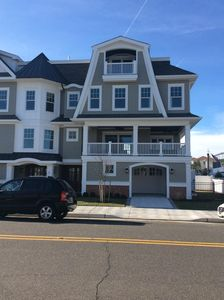 Photo for BEAUTIFUL BEACH BLOCK TOWNHOME WITH ELEVATOR OCEAN VIEWS  STEPS TO BEACH/BOARDS
