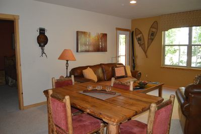 Comfortable seating in dining area. Locally handcrafted using pine-beetle kill wood. Chairs are very comfortable.