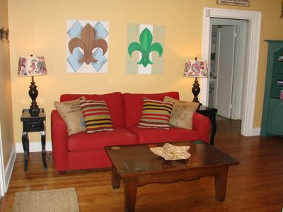 Enter this charming living room. The red couch is a pull out queen.