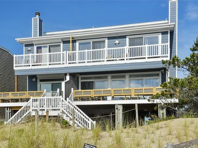Photo for FREE ACTIVITIES!! Amazing location sits directly on the beach offers incredible ocean views and glorious sunrises!  Step off the deck onto the sand