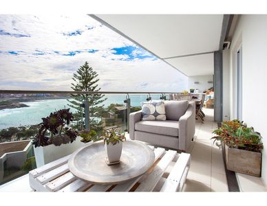 Photo for Unbeatable beachside apartment with epic view