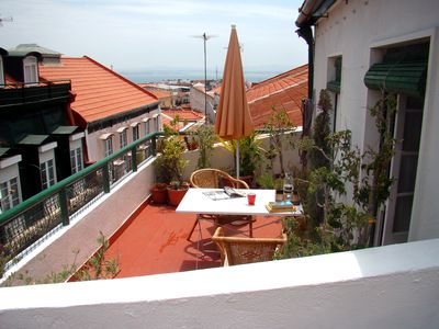 Photo for Relaxing apartment, with panoramic terrace, in the most 'IN' Lisbon quarter