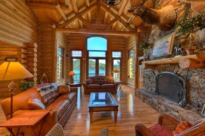 The Great Room features soaring ceilings and windows with panoramic views.