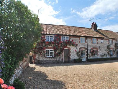 Photo for A charming example of a traditional brick and flint Norfolk cottage in Thornham.