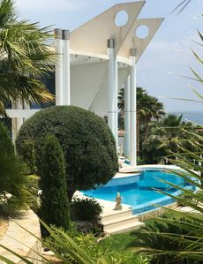 Photo for Family-friendly, modern luxury villa by the sea with large pool, garden, garage