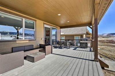 The vacation rental home boasts a large furnished deck - ideal for barbecuing!