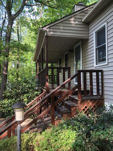 Photo for Charming Cottage on Wooded Lot Close to Downtown