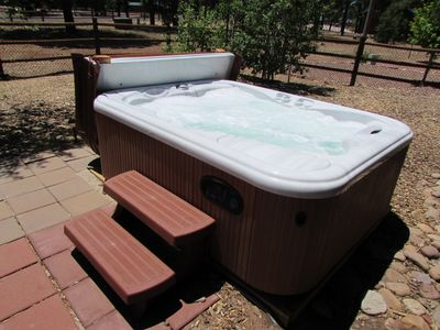 Relax in clean four person hot tub