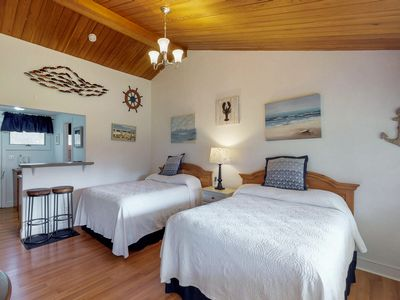 Photo for Comfortable condo with shared tennis courts & pool - close to beaches