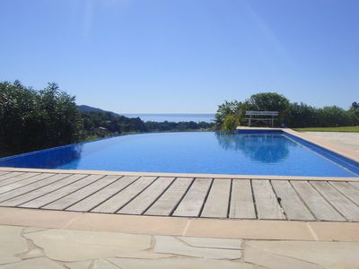 Photo for Villa ideally placed, 8 minutes from the beach, sea view, infinity pool