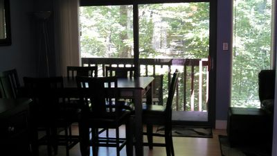 Downstairs balcony opens off dining area