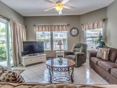 Photo for Spacious condo near beaches w/ putting green, hot tubs-close to largest pool!
