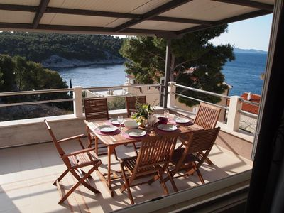 Photo for Two bedroom apartment with terrace and sea view Cove Osibova (Brač)