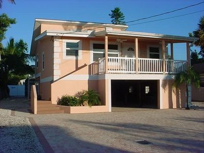 Key West Flair with Paver Drive and 2 Car Garage