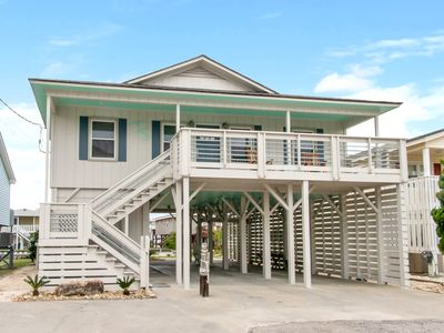 Photo for Newly updated waterfront home with channel deck - only one block from the beach!