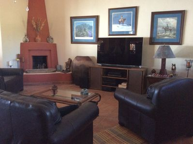 Living room with 65' satellite TV