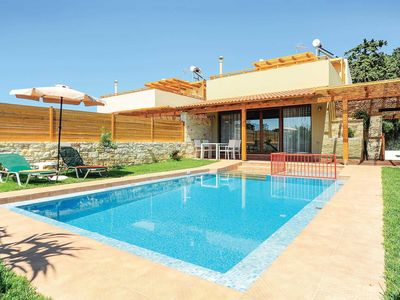 Photo for Well-furnished resort villa within walking distance of shops and beach, with a pool
