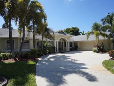 Photo for Casa Libra - Cape Coral 3b/2.5ba  luxury home w/electric heated pool, gulf access canal, HSW Interne