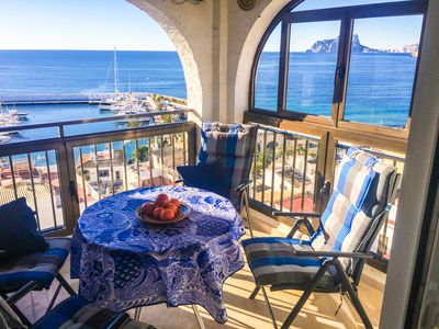 Photo for Front Line Moraira Apartment overlooking the Marina with stunning Sea Views