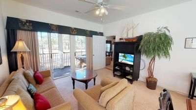 Photo for Sunny, End Top floor unit Condo! Close to Beach. INCLUDES Pools & Amenities!