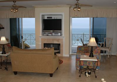 Living Room with two patio doors to balcony