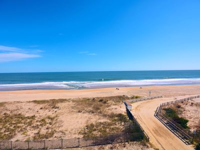 Photo for Pristine, bright 1 bedroom oceanfront condo with free WiFi, coastal decor, and a gorgeous view of the ocean located in quiet midtown and only a few steps from the beach!
