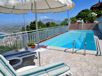 Photo for 4 bedroom Villa, sleeps 6 with Pool, Air Con, WiFi and Walk to Shops
