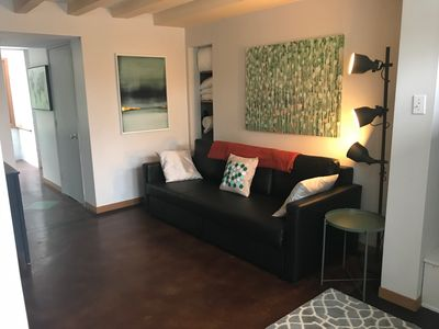 Living room with pull out sofa that sleeps 2 comfortably.