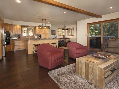 Photo for Close to town! Home can accommodate several families. Hot tub, game room & deck!