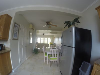 Dining area and living room as seen from kitchen.