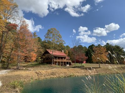 Photo for Secluded hilltop log cabin with fishing pond, stunning views, & nature trails