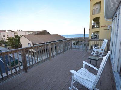 Photo for Spacious, comfortable luxury 4 bedroom townhouse with free WiFi and enclosed and unenclosed decks located midtown on the ocean block just a quick stroll to the beach!