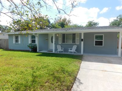 Photo for Remodeled and tastefully furnished 4 bed 2 1/2 bath pool home close to beaches.