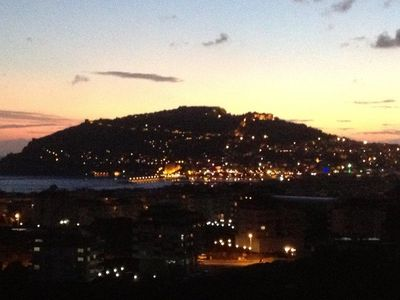 sun set view. Discotheeks in the harbour show their lights. Fire works every day