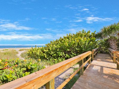 Photo for Beachside condo w/ furnished patio & full kitchen - just steps from the sand!